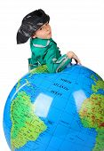 Boy In Historical Dress Leans On Inflatable Globe Isolated On White