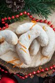 picture of crescent-shaped  - Christmas nut crescent cookies on festive background