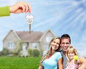 image of dream home  - Happy Family near new home - JPG