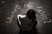 stock photo of lost love  - Young girl sitting on the floor in front of the inscription where is the love - JPG