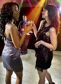 image of seducing  - women seducing a man at a bar or nightclub  - JPG