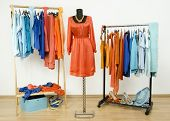 image of dress mannequin  - Dressing closet with clothes shoes and accessories and a dress on a mannequin.