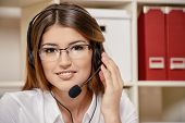 pic of telephone operator  - Friendly smiling young woman surrort phone operator at her workplace in the office - JPG