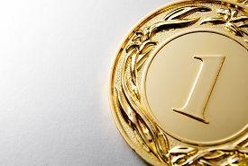 stock photo of gold medal  - Gold medal winner on a white background - JPG