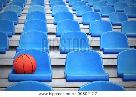 Basketball ball on stadium seat