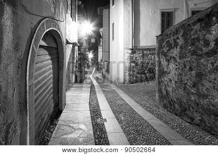 Orta San Giulio old city, night view. Black and white photo