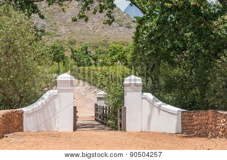 Boundary Wall And Wooden Bridge