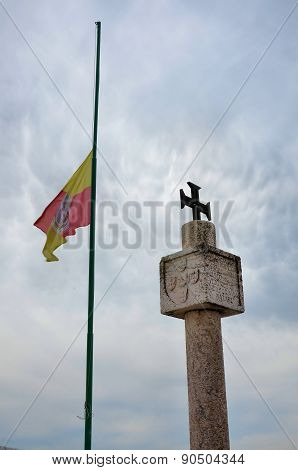 Stone landmark and flag
