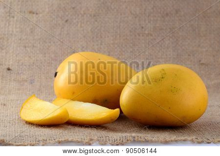 Mango fruit with slice on sack cloth