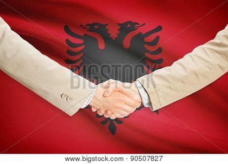 Businessmen Handshake With Flag On Background - Albania