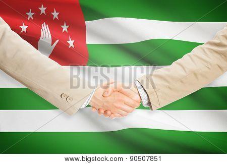 Businessmen Handshake With Flag On Background - Abkhazia