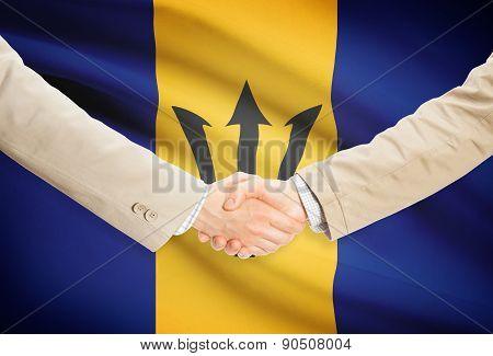 Businessmen Handshake With Flag On Background - Barbados