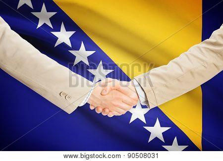 Businessmen Handshake With Flag On Background - Bosnia And Herzegovina