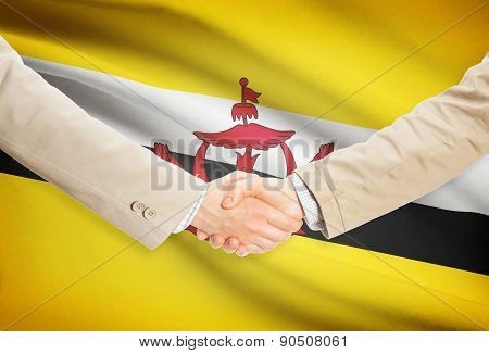 Businessmen Handshake With Flag On Background - Brunei