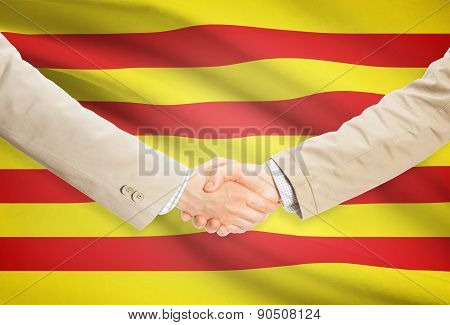 Businessmen Handshake With Flag On Background - Catalonia - Spain