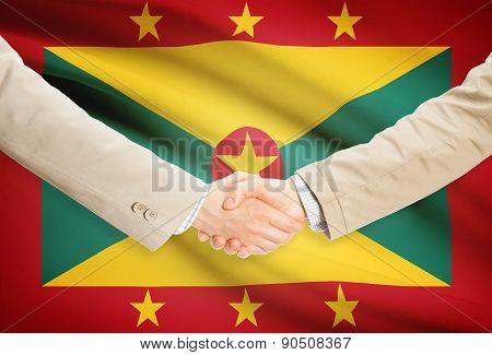 Businessmen Handshake With Flag On Background - Grenada