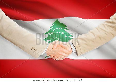 Businessmen Handshake With Flag On Background - Lebanon