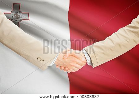 Businessmen Handshake With Flag On Background - Malta