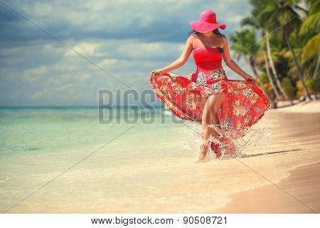 Carefree, Young Woman Relaxing On The Islands Beach