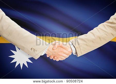 Businessmen Handshake With Flag On Background - Nauru
