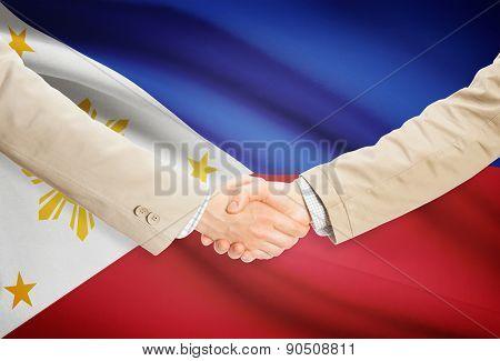 Businessmen Handshake With Flag On Background - Philippines