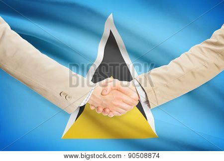 Businessmen Handshake With Flag On Background - Saint Lucia