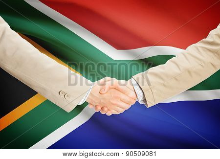 Businessmen Handshake With Flag On Background - South Africa