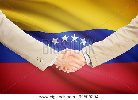Businessmen Handshake With Flag On Background - Venezuela
