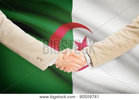 Businessmen Handshake With Flag On Background - Algeria