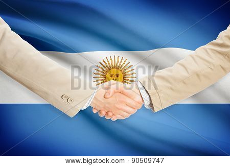 Businessmen Handshake With Flag On Background - Argentina