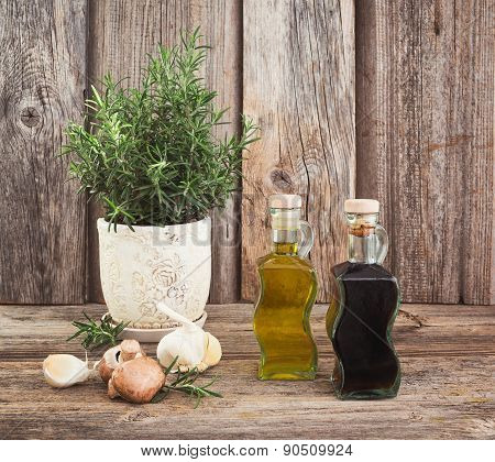 Olive oil and vinegar in bottles with garlic and rosemary.Toned