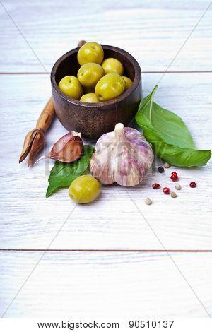 Green olives, basil, garlic and oil