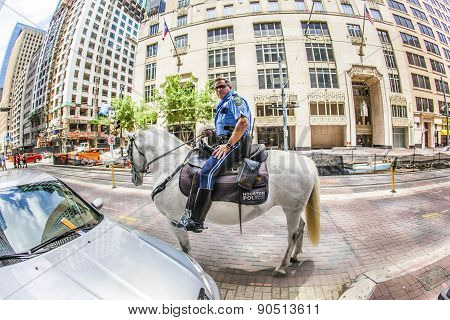 Policeman On Horse Checks Correct Parking
