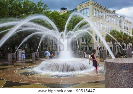 Kids playing in fountain in downtown Charleston South Carolina, motion blur on people
