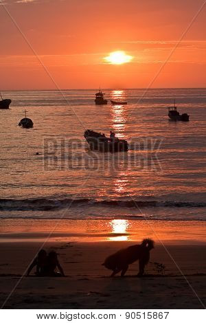 Beautiful landscape view of floating fishing boats with amazing sunset in the background, Manabi, Ec