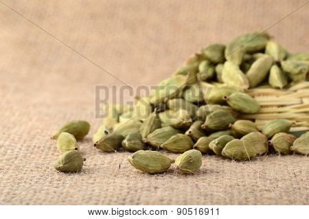 Green Cardamom pods on sack cloth