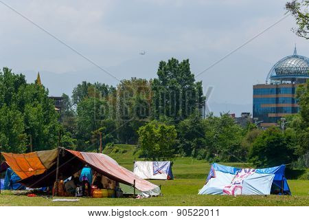 KATHMANDU, NEPAL - MAY 13, 2015: The Nepal Golf Course next to Kathmandu airport is used as a makeshift campsite after a 7.3 earthquake hit Nepal on May 12, 2015.