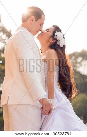 Kissing Bridal Couple