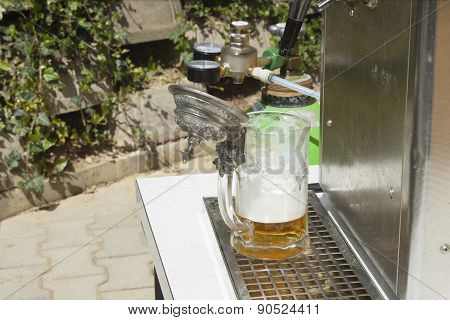 pouring beer at the party