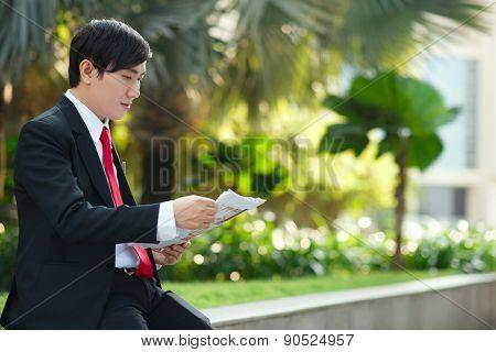 Reading Financial Newspaper