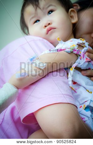 Mother Carrying Sick Baby,shallow Dof