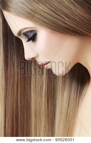 Profile portrait of young beautiful woman with long hair, selective focus