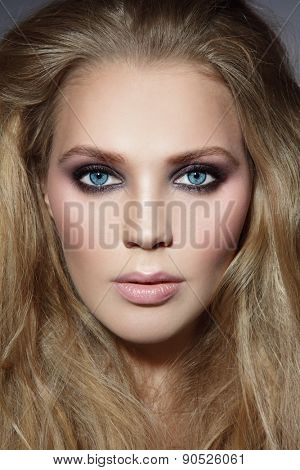 Close-up portrait of young beautiful stylish woman with smoky eyes