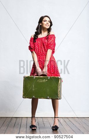 Young and beautiful woman with a suitcase. Traveling, summer holidays and vacation concept.