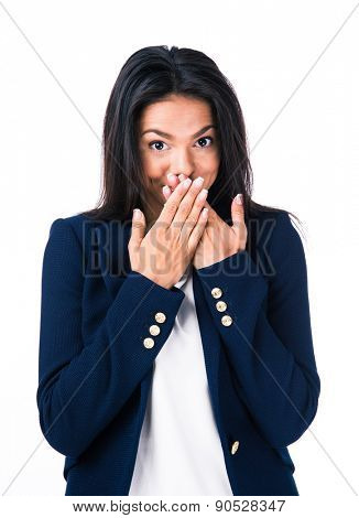 Young businesswoman covering her mouth with hands and looking at camera. Isolated over white background