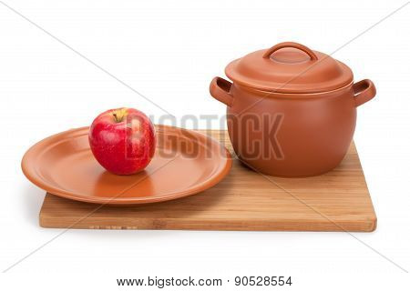 Apple And Earthenware Crockery On A Cutting Board
