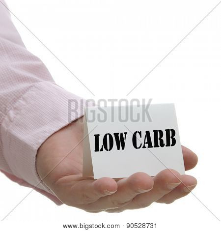 Business man holding low carb sign on hand