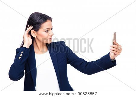 Beautiful businesswoman making selfie photo on smartphone over white background