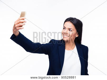 Cheerful businesswoman making selfie photo on smartphone over white background