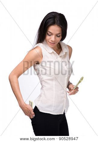 Businesswoman putting money in pocket over white background